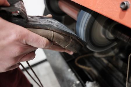 shoemaker at work Foto de archivo