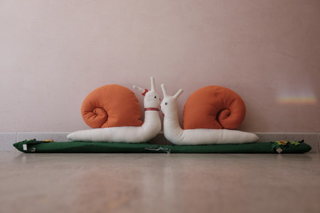 draft excluders in the shape of a snail