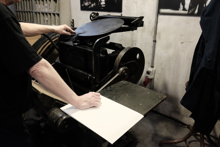 operator at work on old typographic machine