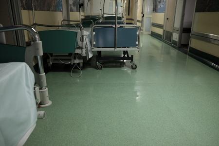 empty stretchers on the hospital corridor
