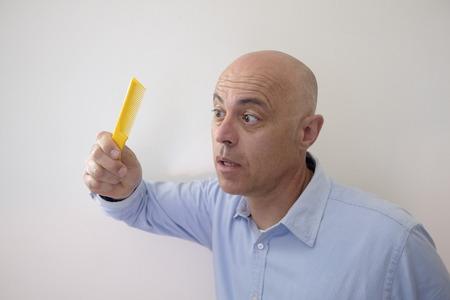 Bald man with comb Archivio Fotografico
