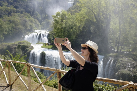 girl takes selfie at the marmore waterfalls