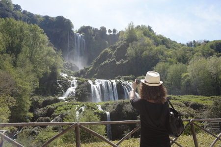 The girl admires Marmore waterfalls