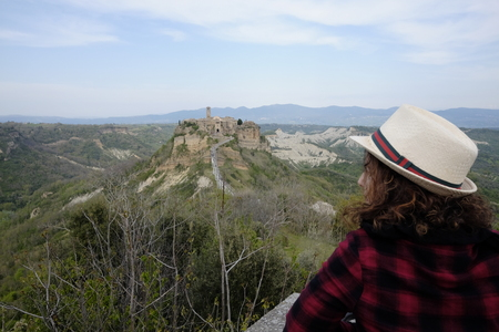 tourist admires the city of civita di bagnoregio