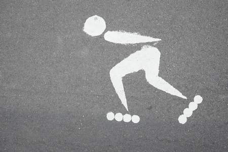symbol of roller skating on the asphalt