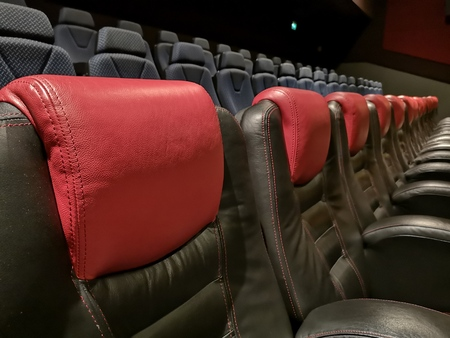 red leather armchairs in the empty cinema Banco de Imagens