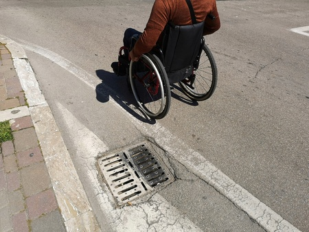 wheelchair in the streets of the city