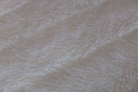 detail of white fur pillow