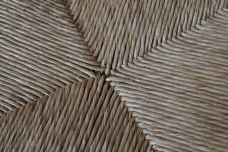 macro detail of a straw chair