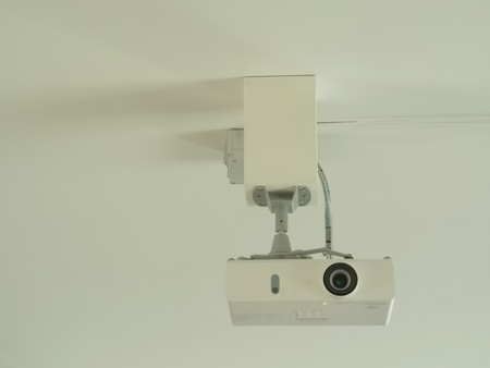 video projector attached to the ceiling Banco de Imagens