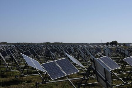 expanse of solar panels in the sunny countryside