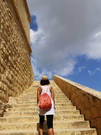 tourist on the tuff stairway, Victoria a gozo Stock Photo