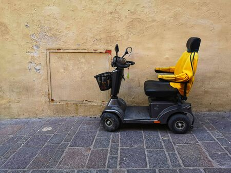 Empty electric wheelchair in the street