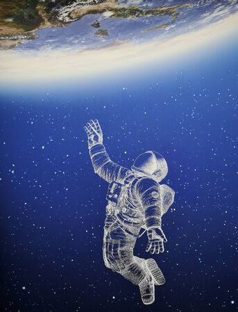 astronaut suspended in space touching the earth Banque d'images