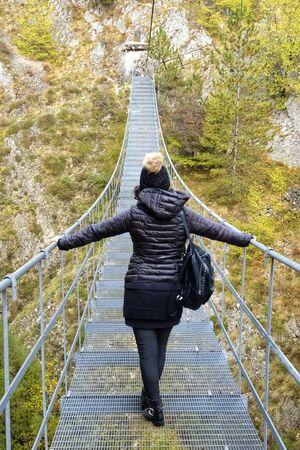 girl on the Tibetan bridge of roccamandolfi Banco de Imagens
