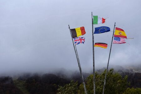 flags of various European countries on the roadside
