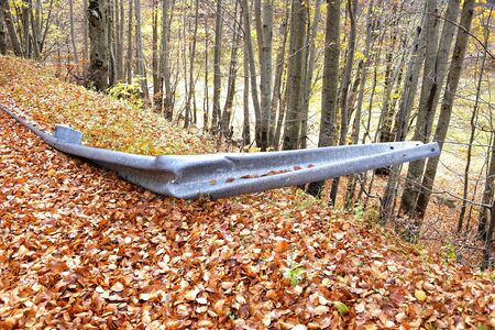 guardrail returned to the mountain road