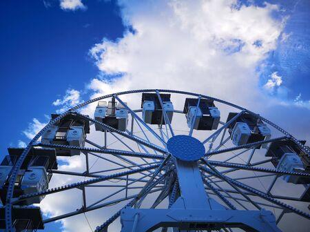 ferris wheel with blue sky background Banco de Imagens