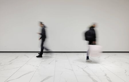 People out of focus at the airport