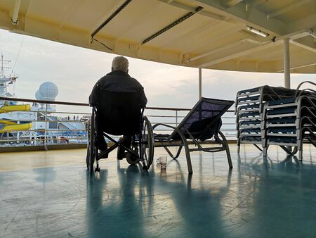 man in wheelchair on cruise ship