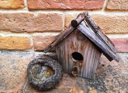 empty nest and birdhouse