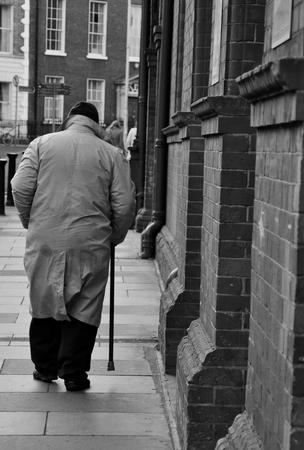 aloneness: Old man walking in Dublin