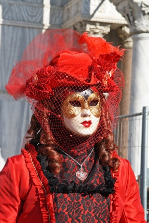 VENICE, ITALY - MARCH 4 2011: Detail of unidentified masked person standing in front of Palazzo Ducale in Venice, Italy, on 4 March during popular Venice carnival (held on 26 February - 8 March 2011).