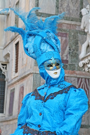VENICE, ITALY - MARCH 4 2011: Detail of unidentified masked person standing on the street in Venice, Italy, on 4 March during popular Venice carnival (held on 26 February - 8 March 2011). Editorial