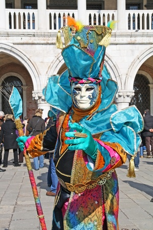 VENICE, ITALY - MARCH 4: An unidentified masked person stands in front of Palazzo Ducale during the Venice Carnival on March 4, 2011 in Venice, Italy. The carnival is from February 26 - March 8, 2011.