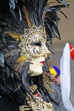 VENICE, ITALY - MARCH 5: An unidentified masked person walks down the street during the Venice Carnival on March 5, 2011 in Venice, Italy. The carnival is from February 26 - March 8, 2011.