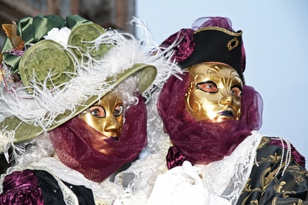 VENICE, ITALY - MARCH 3: Unidentified masked persons stand on the street during the Venice Carnival on March 3, 2011 in Venice, Italy. The carnival is from February 26 - March 8, 2011.