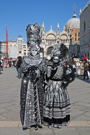 VENICE, ITALY - MARCH 4: Unidentified masked persons pose on San Marco square during the Venice Carnival on March 4, 2011 in Venice, Italy. The carnival is from February 26 - March 8, 2011.