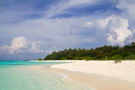 Tropical island with white sand and azure water, Maldives Stock Photo
