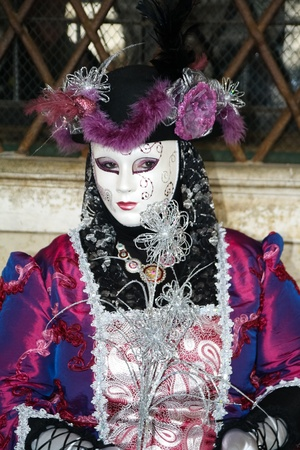 VENICE, ITALY - MARCH 3: An unidentified masked person stands in front of the Palazzo Ducale during the Venice Carnival on March 3, 2011 in Venice, Italy. The carnival is from February 26 - March 8, 2011. Stock Photo - 11542517