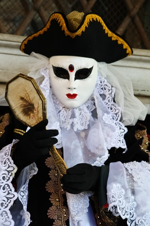 VENICE, ITALY - MARCH 4: An unidentified masked person stands in front of the Palazzo Ducale during the Venice Carnival on March 4, 2011 in Venice, Italy. The carnival is from February 26 - March 8, 2011. Editorial