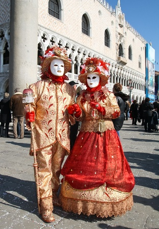VENICE, ITALY - MARCH 6: Unidentified masked persons stand in front of Palazzo Ducale during the Venice Carnival on March 6, 2011 in Venice, Italy. The carnival is from February 26 - March 8, 2011.