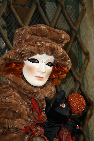 VENICE, ITALY - MARCH 3: An unidentified masked person stands in front of Palazzo Ducale during the Venice Carnival on March 3, 2011 in Venice, Italy. The carnival is from February 26 - March 8, 2011.