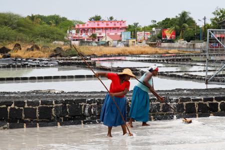 desalination: TAMARIN, MAURITIUS - OCTOBER 30: Two unidentified women desalinating water, October 30, 2013 in Tamarin, Mauritius.