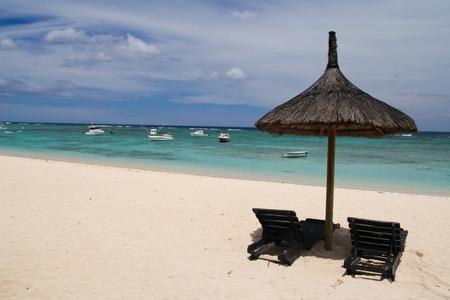 Umbrella with two chairs on the beach, Mauritius