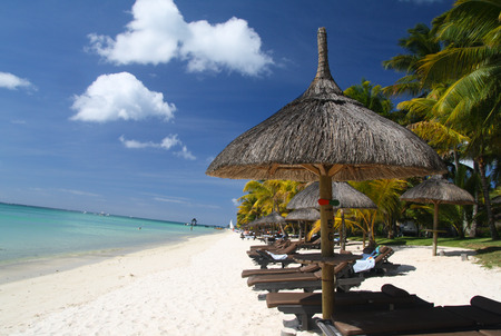 Umbrella with sun beds on tropical beach, Mauritius