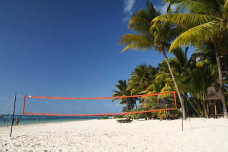 Tropical beach with volleyball net under palm trees, Mauritius