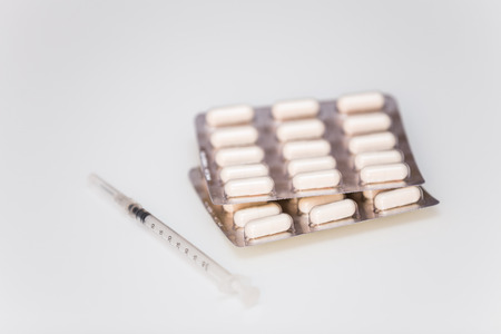 abuser: Medicine pills and syringe Stock Photo
