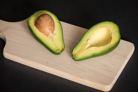 sectioned: Sectioned avocado on a chopping board