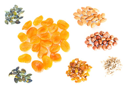 Delicacies, different spices scattered on the white background