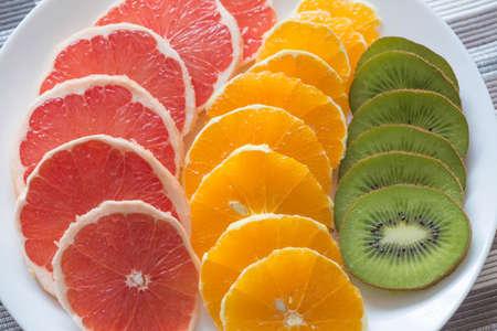 Cutting fresh fruits  vitamins concept