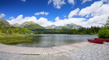 tatra: Panorama of mountain lake Strbske Pleso in the Tatra mountains. Summers colors and boat for swimming