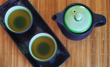 sencha: Brewed and healthy Japanese green tea served in traditional hohin and shiboridashi dishes Stock Photo