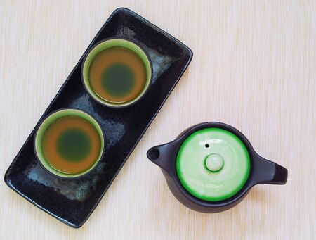 Brewed and healthy Japanese green tea served in traditional hohin and shiboridashi dishes Stock Photo