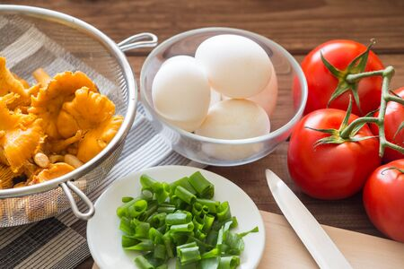 Chanterelle mushrooms and eggs and fresh chives for breakfast Stock Photo