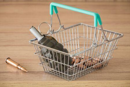 Arms trade, Shopping basket with grenade, concept